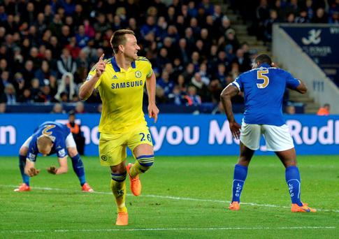 John Terry wheels away after scoring the second goal against Leicester City at the King Power Stadium