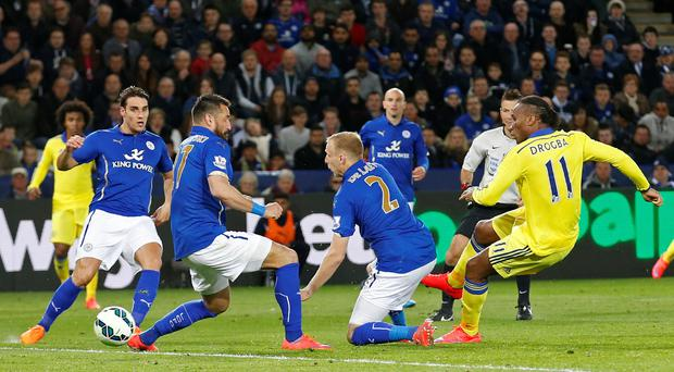 Didier Drogba strikes to score Chelsea's equalising goal against Leicester last night