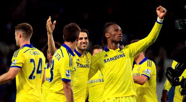 (Left to right) Chelsea's Cesar Azpilicueta, Cesc Fabregas and Didier Drogba celebrate after the Barclays Premier League match at The King Power Stadium, Leicester