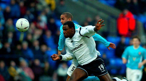 Bolton Wanderers' Delroy Facey (front) battling with Sunderland's Phil Babb, as former Premier League striker Facey has been convicted of conspiring to bribe players in a match-fixing plot