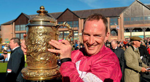 Jockey Paul Carberry lifts thethe Bibby Financial Services Ireland Punchestown Gold Cup after victory on Don Cossack. Punchestown Racecourse, Punchestown, Co. Kildare
