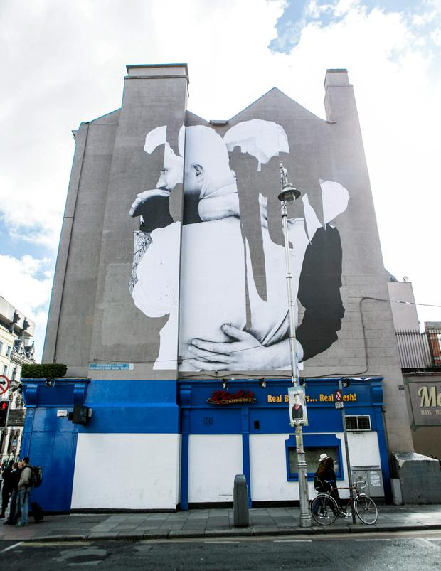 A Mural on the Corner of Georges St and Dame St depicting Two Embracing Men.