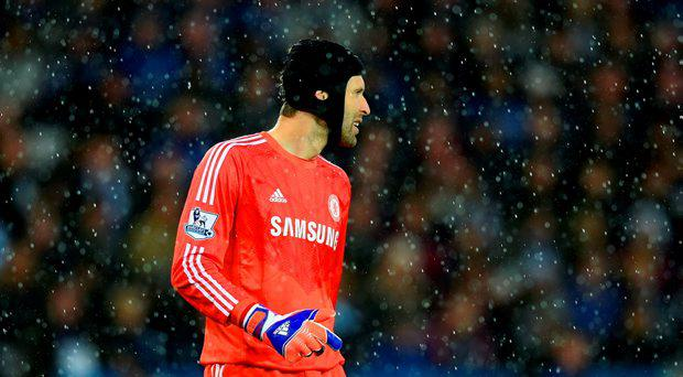 Petr Cech of Chelsea looks on through the rain during the Barclays Premier League match between Leicester City and Chelsea at The King Power Stadium on April 29, 2015 in Leicester, England