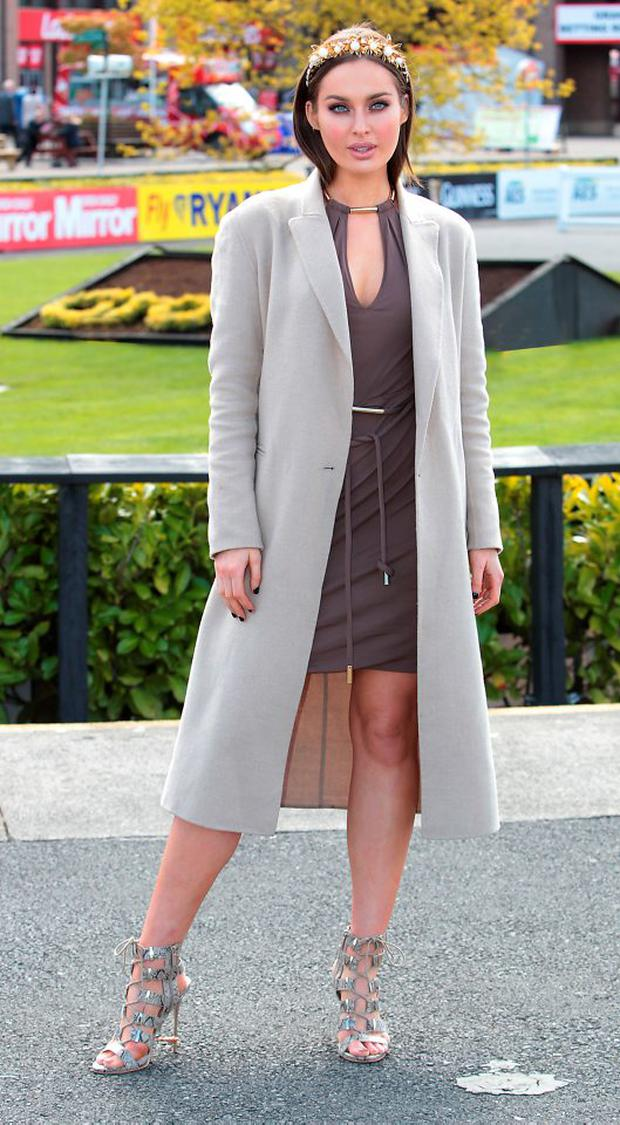 Rozanna Purcell judges Day 3 of the Gold Fever Best Dressed Lady at the opening of The Punchestown Festival