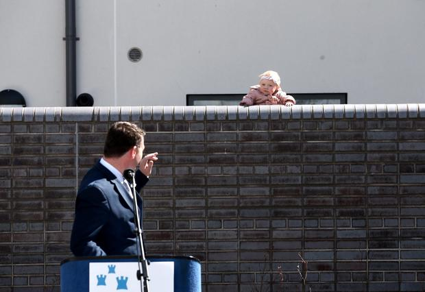 Minister Alan Kelly waves to 11-month-old Emily Rose O'Neill. Photo: Jason Clarke Photography