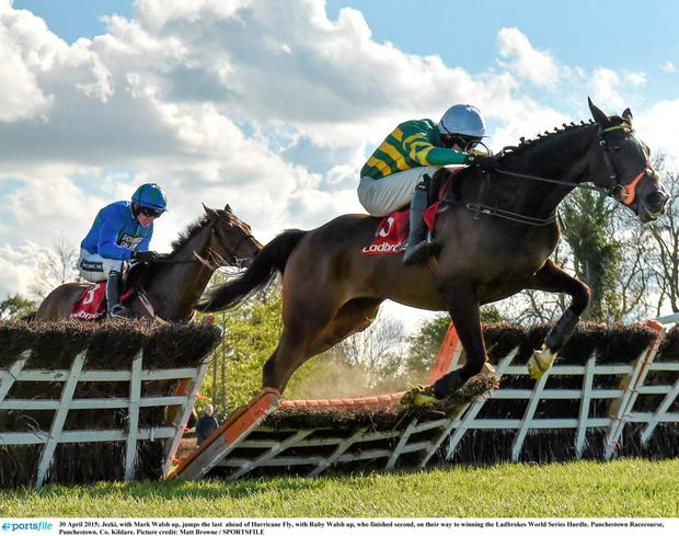 30 April 2015; Jezki, with Mark Walsh up, jumps the last ahead of Hurricane Fly, with Ruby Walsh up, who finished second, on their way to winning the Ladbrokes World Series Hurdle. Punchestown Racecourse, Punchestown, Co. Kildare. Picture credit: Matt Browne / SPORTSFILE