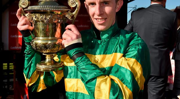 30 April 2015; Jockey Mark Walsh with the Ladbrokes World Series Hurdle Cup after victory on Jezki. Punchestown Racecourse, Punchestown, Co. Kildare. Picture credit: Matt Browne / SPORTSFILE