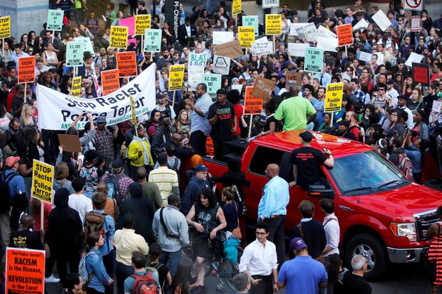 Protesters against police violence stop traffic at a major intersection Credit: Jonathan Ernst