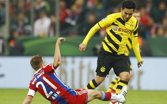Bayern's Philipp Lahm, left, and Dortmund's Ilkay Gundogan
