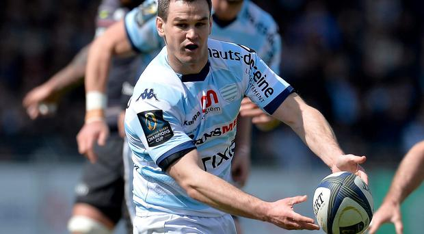 Jonathan Sexton of Racing Metro 92 passes the ball during the European Rugby Champions Cup quarter final match between Racing Metro 92 and Saracens at Stade Yves Du Manoir