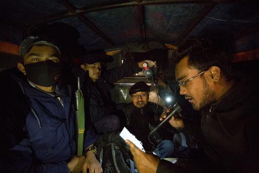 Armed Police in Kathmandu, Nepal plead with the public to disperse after a hoax earthquake prediction. Pic:Mark Condren