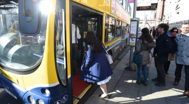 A woman climbs abroad a Dublin bus today but none will be on the streets today as strike talks have failed