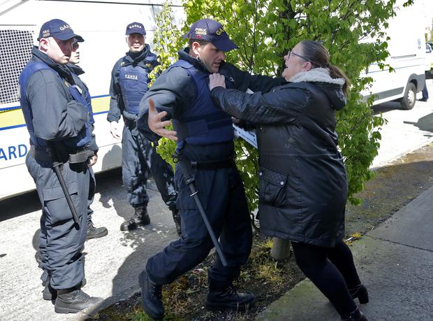Gardai and water charge protestors clash as Minister Alan Kelly attempts to leave at the official opening of Grand Canal View in Bluebell yesterday. Photo: Colin Keegan, Collins Dublin