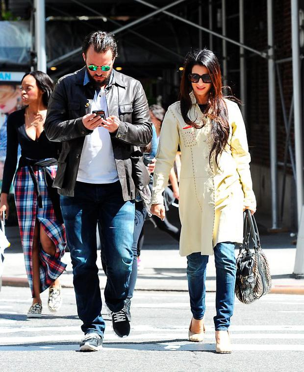 Tala Alamuddin takes a walk with her boyfriend while her sister Amal Clooney celebrates her anniversary in NYC