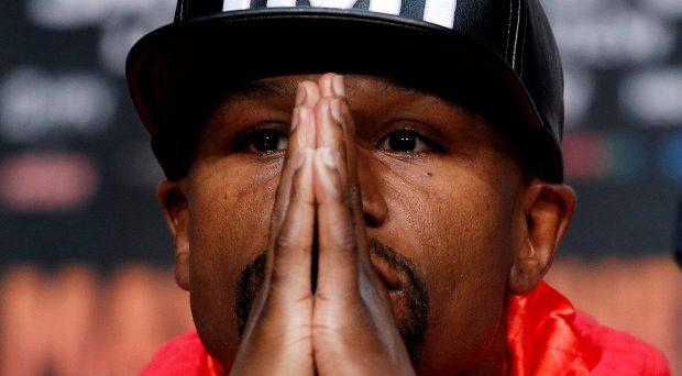 Boxer Floyd Mayweather Jr. listens during a press conference