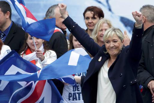 France's far-right National Front political party leader Marine Le Pen waves to the crowd of supporters at the end of her speech during their traditional May Day tribute to Joan of Arc in Paris, France REUTERS/Philippe Wojazer