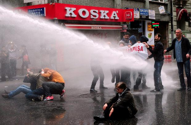 Turkish police use water cannon to disperse protestors during a May Day rally in Istanbul Credit: Ozan Kose