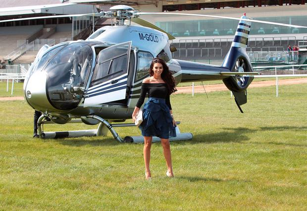 Georgia Salpa with the Gold Fever helicopter as she heads for the final of the Best Dressed Competition at Gold Fever Ladies Day at The Punchestown Festival 2015