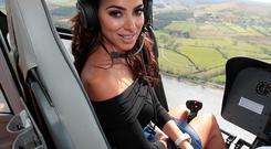 Georgia Salpa on board the Gold Fever helicopter as she heads for the final of the Best Dressed Competition at Gold Fever Ladies Day at The Punchestown Festival 2015