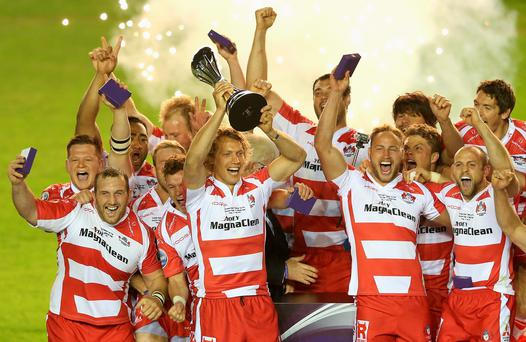 Billy Twelvetrees, the Gloucester captain, raises the European Challenge Cup trophy after his teams victory against Edinburgh last night