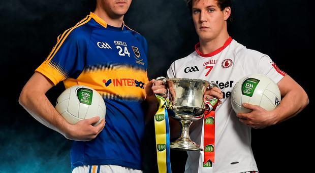 Tyrone U-21 captain Kieran McGeary (right) will be battling it out with his Tipperary counterpart Colin O'Riordan to get his hands on the trophy in today's EirGrid All-Ireland U-21 football final at Parnell Park