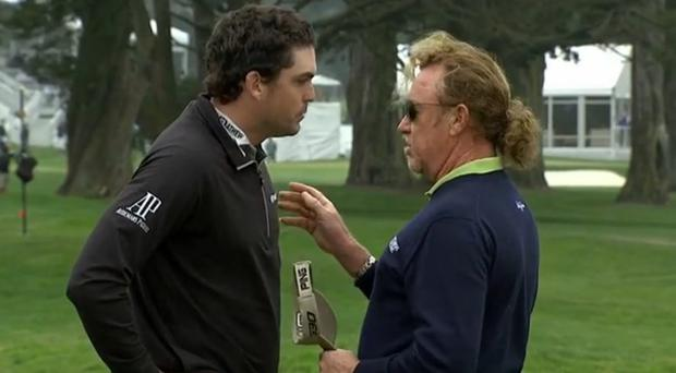 Keegan Bradley and Miguel Angel Jimenez share some words