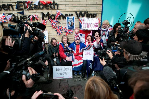 Royal fans and wellwishers react outside the Lindo Wing of St Mary's Hospital in Paddington, London, after Kensington Palace announced that the Duchess of Cambridge had given birth to a girl.