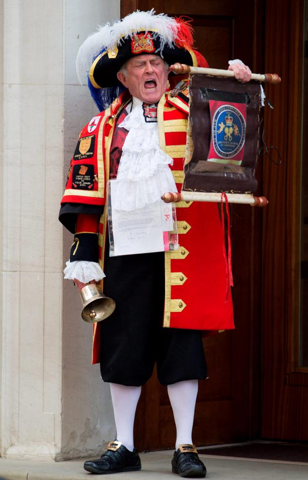 Town Crier Tony Appleton outside the Lindo Wing of St Mary's Hospital in Paddington, London, after Kensington Palace announced that the Duchess of Cambridge had given birth to a girl.