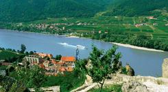 Just cruising: The 'River Beatrice' sails majestically past the picturesque town of Durnstein in Austria