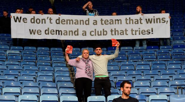 Newcastle fans protest against owner Mike Ashley during the Barclays Premier League match between Leicester City and Newcastle United at The King Power Stadium