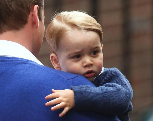 May 2015: Britain's Prince William returns with his son George to the Lindo Wing of St Mary's Hospital, after the birth of his daughter in London, Britain May 2, 2015. Britain's Duchess of Cambridge, has given birth to a daughter, the couple's residence Kensington Palace announced on Saturday. REUTERS/Neil Hall