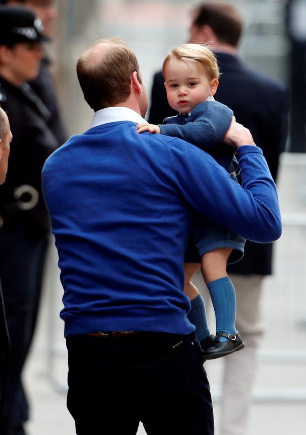 The Duke of Cambridge with his son Prince George as he arrives at the Lindo Wing of St Mary's Hospital in London, after the birth of his newborn daughter. PRESS ASSOCIATION Photo. Picture date: Saturday May 2, 2015. See PA story ROYAL Baby. Photo credit should read: Steve Parsons/PA Wire