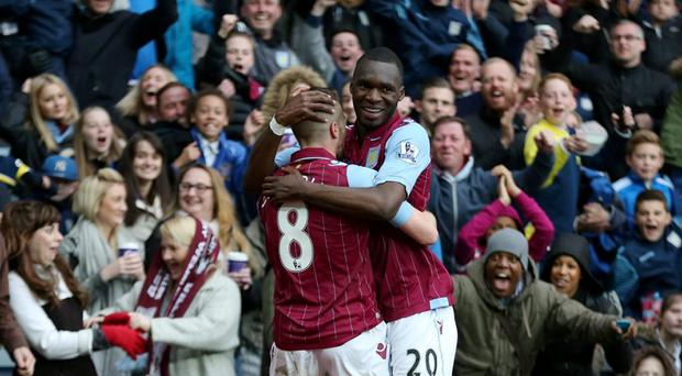 Aston Villa's Tom Cleverley celebrates scoring their third goal with Christian Benteke Action Images via Reuters / Matthew Childs Livepic