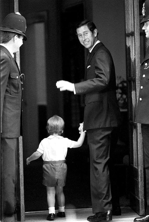 File photo dated 16/9/1984 of the Prince of Wales and his two-year-old son Prince William entering the Lindo Wing of St. Mary's Hospital, London, to visit the Princess of Wales and Prince Harry who she gave birth to the previous day.