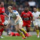 Clermont's fullback Nick Abendanon (2nd L) on his way to scoring a try during the European Rugby Champions Cup rugby union final match between Clermont and Toulon at Twickenham Stadium, south west of London on May 2, 2015. AFP PHOTO / ADRIAN DENNISADRIAN DENNIS/AFP/Getty Images