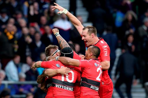 Drew Mitchell (L-headband) of Toulon is congratulated by teammates after scoring his team's second try during the European Rugby Champions Cup Final match between ASM Clermont Auvergne and RC Toulon at Twickenham