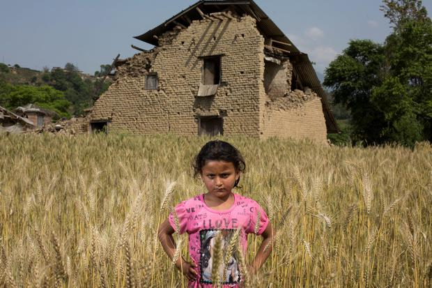 Anuja Maharjan (7) outside her familys restaurant near Bungamati which was devastated in the Nepal earthquake. Pic:Mark Condren 1.5.2015
