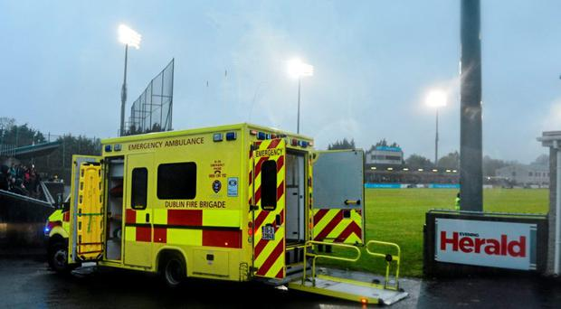 An ambulance sits pitchside while medics treat two supporters for separate injuries, which caused a delay to the start of the second half. A 78-year-old man subsequently died. Picture credit: Ramsey Cardy / SPORTSFILE
