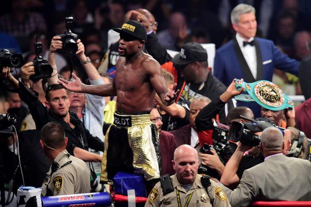Floyd Mayweather celebrates after defeating Manny Pacquiao (not pictured) via unanimous decision during their world welterweight championship bout at MGM Grand