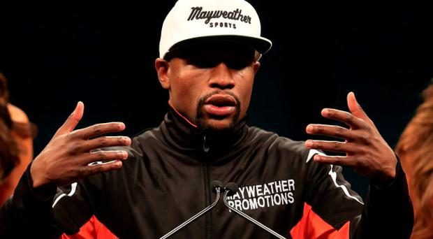 Floyd Mayweather Jr. addresses the media during the post-fight news conference after his unanimous decision victory against Manny Pacquiao in their welterweight unification championship bout at MGM Grand Garden Arena in Las Vegas
