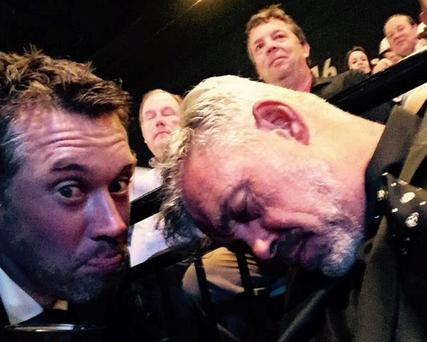 Lee Westwood poses with a sleeping Darren Clarke