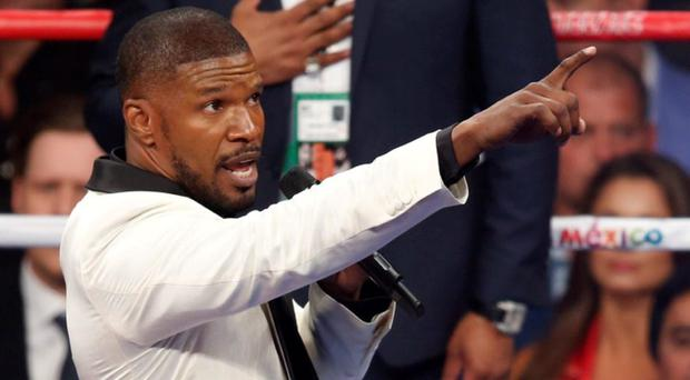Actor Jamie Foxx sings the national anthem before Floyd Mayweather Jr., and Manny Pacquiao's welterweight title fight in Las Vegas. (AP Photo/Eric Jamison)