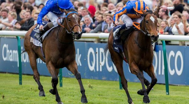 Legatissimo ridden by Ryan Moore (right) gets the better of Lucida ridden by Kevin Manning before going on to win the QIPCO 1000 Guineas Stakes Race run during the QIPCO 1000 Guineas day of the QIPCO Guineas Festival at Newmarket