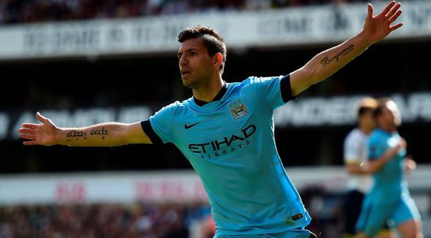 Sergio Aguero of Manchester City celebrates scoring the opening goal during the Barclays Premier League match between Tottenham Hotspur and Manchester City at White Hart Lane