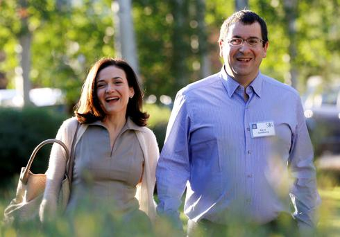 Sheryl Sandberg, Chief Operating Officer (COO) of Facebook, with her husband David Goldberg, CEO of SurveyMonkey REUTERS/Rick Wilking/Files