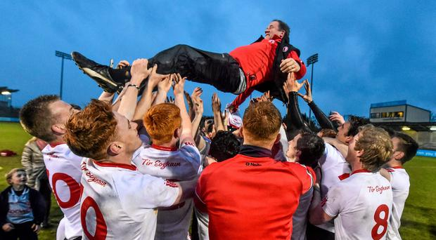 Tyrone manager Feargal Logan celebrates with his side after winning the EirGrid U21 football title against Tipperary