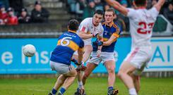 Tyrone's Lee Brennan in action against Tipperary deuo Luke Boland and Colm O'Shaughnessy in the EirGrid All-Ireland U21 football final