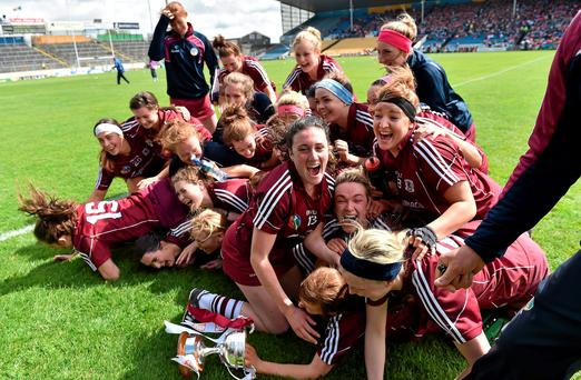 Galway players celebrate winning the league title