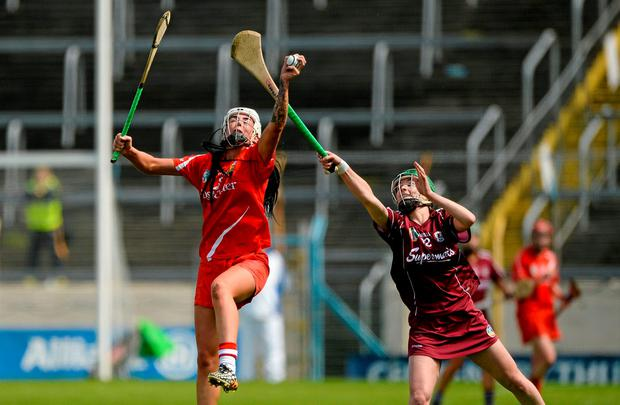 Cork's Ashling Thompson in action against Ann-Marie Starr, Galway