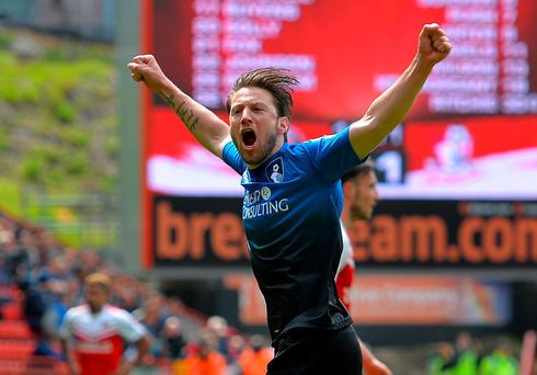 Bournemouth's Harry Arter celebrates scoring on Saturday as the Championship's surprise team wrapped up the league title